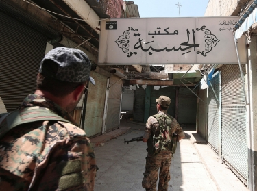 Syria Democratic Forces fighters inspect a center used by Islamic State religious police in Manbij, Aleppo Governorate, Syria, August 16, 2016