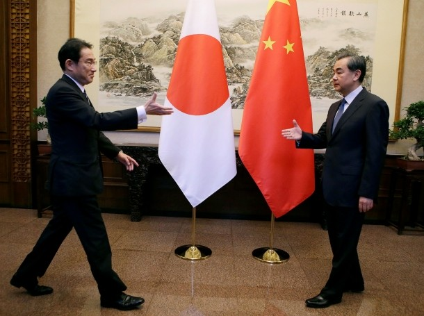 Japanese Foreign Minister Fumio Kishida and China's Foreign Minister Wang Yi meet at Diaoyutai State Guesthouse, in Beijing, China, April 30, 2016