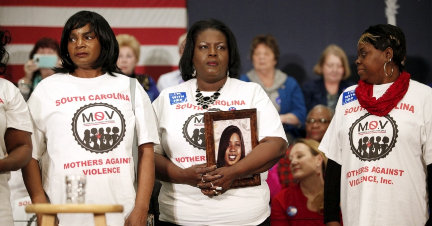 Barbara Hytower, holding a photo of her daughter Jamila who was murdered in Myrtle Beach, stands with other members of South Carolina Mothers Against Violence before the start of a rally, February 25, 2016