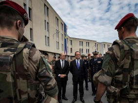 French President Francois Hollande and Defence Minister Jean-Yves Le Drian review troops at the fort of Vincennes, France, July 25, 2016