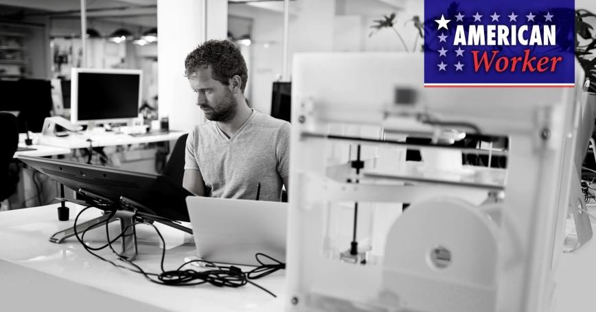 A man working at a 3D printer