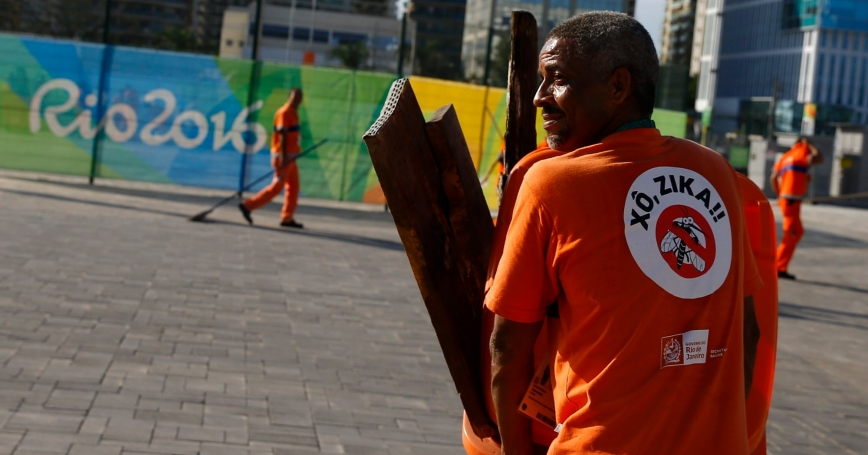 "A worker wears a sign that reads ""Shoo Zika!"" in Portuguese on his back in Olympic Park in Rio de Janeiro, Brazil, July 31, 2016"