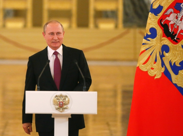 Russian President Vladimir Putin arrives for a personal send-off for members of the Russian Olympic team at the Kremlin in Moscow, Russia, July 27, 2016