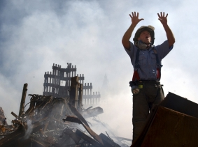 A New York City fireman calls for 10 more rescue workers to make their way into the rubble of the World Trade Center on September 15, 2001