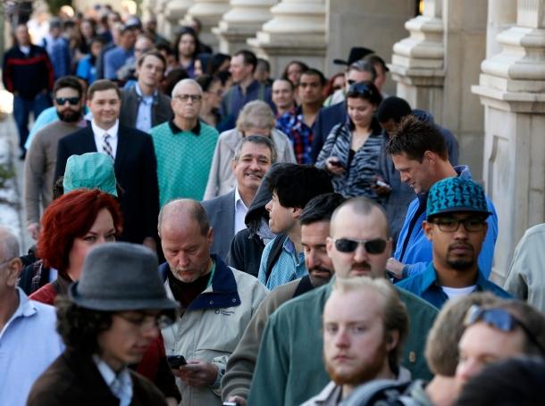 Job seekers wait to enter a job fair in downtown Denver, Colorado, March 13, 2014