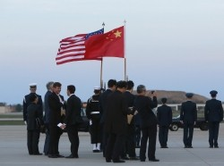 A diplomatic delegation waits for China's President Xi Jinping to arrive at Joint Base Andrews, Maryland, March 30, 2016, to attend the Nuclear Security Summit in Washington