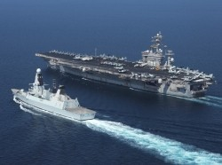 The Royal Navy destroyer HMS Diamond alongside the aircraft carrier USS Dwight D. Eisenhower conducting maritime security operations and support missions for Operation Enduring Freedom, November 4, 2012