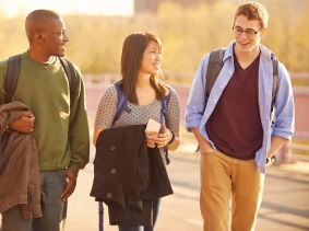 Three college students walking to class