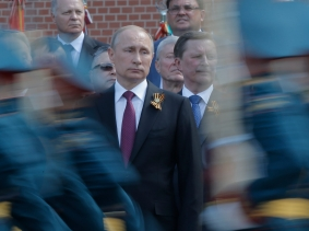 Russian President Vladimir Putin watches honor guards during a wreath-laying ceremony near the Kremlin in Moscow, May 9, 2016, photo by Maxim Shemetov/Reuters