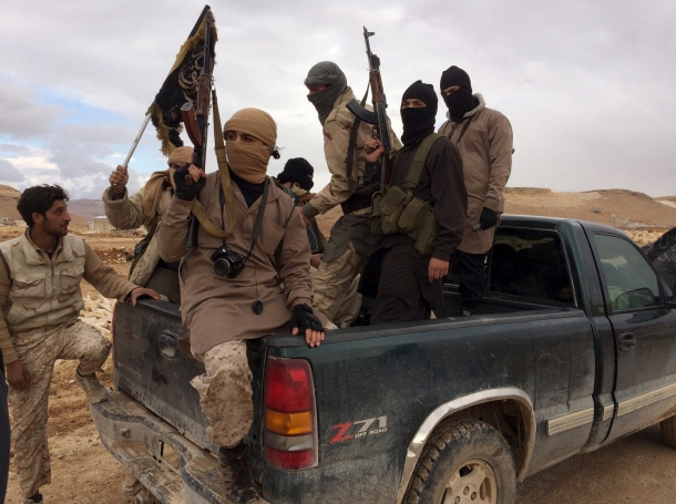 Al Qaeda-linked Nusra Front fighters enter the back of a pick-up truck in Arsal, Lebanon, December 1, 2015