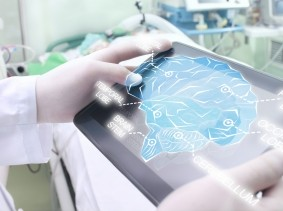 A doctor looking at an image of a human brain on a tablet