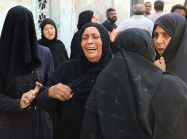 Women mourn the death of their relatives after an airstrike in the rebel held Bab al-Nairab neighborhood of Aleppo, Syria, August 25, 2016