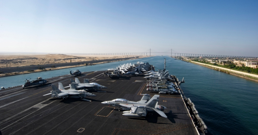 The aircraft carrier USS Dwight D. Eisenhower approaches the Friendship Bridge as it transits the Suez Canal, July 8, 2016