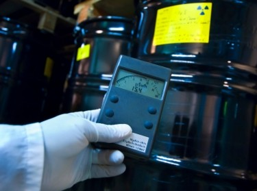Person checking radiation with a geiger counter