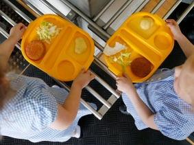 Students receive their lunch at Salusbury Primary School in northwest London, June 11, 2014