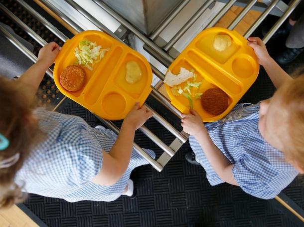 Students receive their lunch at Salusbury Primary School in northwest London, June 11, 2014