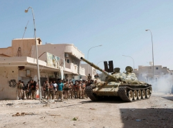 A tank is seen as fighters from Libyan forces allied with the U.N.-backed government take position during a battle with Islamic State militants in Sirte, Libya, September 22, 2016