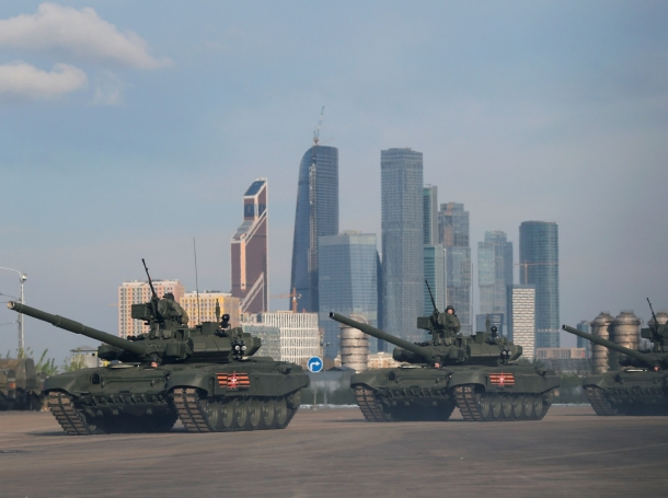 Russian servicemen on Russian T-90A main battle tanks before a rehearsal for the Victory Day parade, with the Moscow International Business Center also known as Moskva-City in the background, May 5, 2016