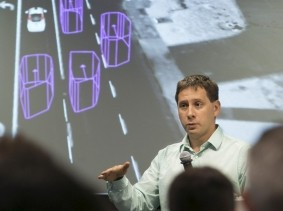 Dmitri Dolgov, principal engineer on the software team of Google's Self-Driving Car project, speaks during a presentation in Mountain View, California, September 29, 2015