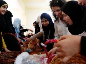 Syrian refugees and Lebanese girls make decorative baskets