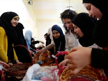 Syrian refugees and Lebanese girls make decorative baskets