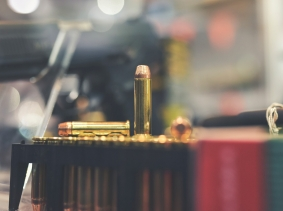 Bullets and firearm on a retail store counter, photo by Filipovic018/Getty Images