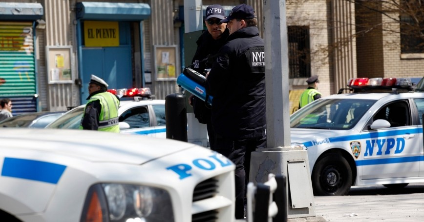 Members of the New York Police Department Counter Terrorism division use a device to test for radiation during a multi-agency 'dirty bomb' exercise led by the NYPD in Brooklyn, New York, April 9, 2011