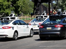 A fleet of Uber's Ford Fusion self-driving cars are shown during a demonstration in Pittsburgh, Pennsylvania, September 13, 2016