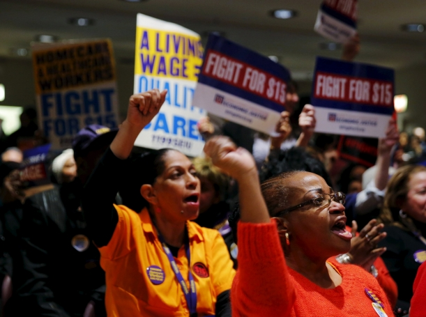 Audience members cheer during a union rally for higher minimum wages in New York City, New York, January 4, 2016