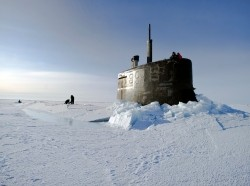 Sailors and members of the Applied Physics Laboratory Ice Station clear ice from the hatch of the Seawolf-class submarine USS Connecticut in the Arctic Ocean, March 19, 2011