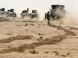Iraqi special forces soldiers drive in a desert near Mosul, Iraq, October 25, 2016