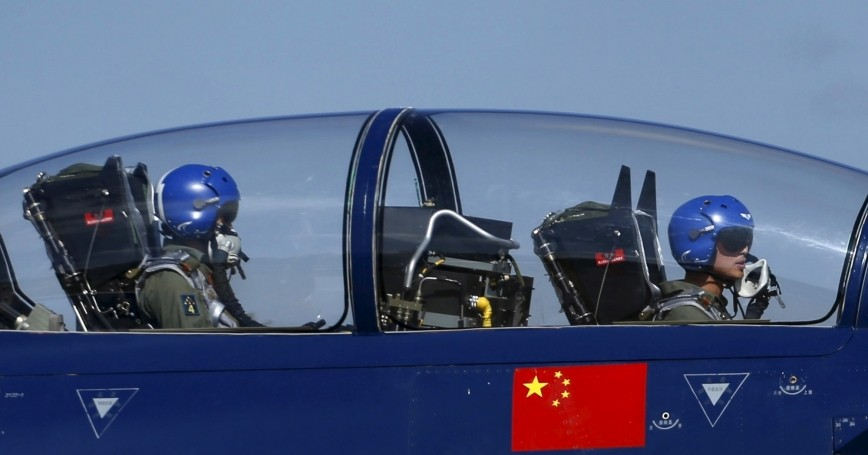 Pilots of China's J-10 fighter jet from a PLAAF Aerobatics Team prepare before a media demonstration at the Korat Royal Thai Air Force Base, Thailand, November 24, 2015