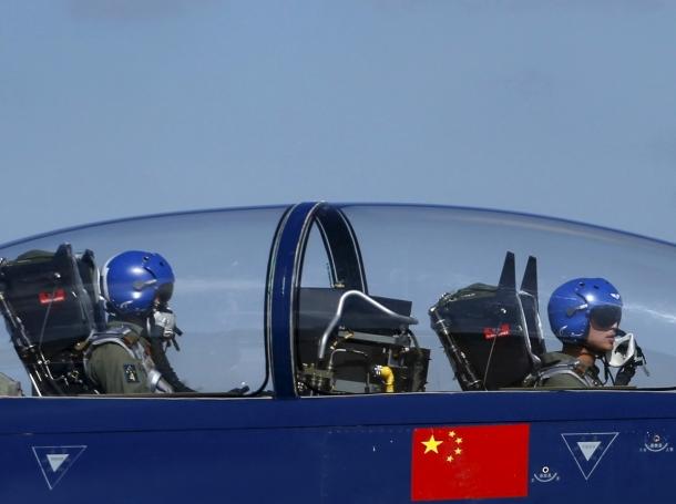 Pilots of China's J-10 fighter jet from a PLAAF Aerobatics Team prepare before a media demonstration at the Korat Royal Thai Air Force Base, Thailand, November 24, 2015
