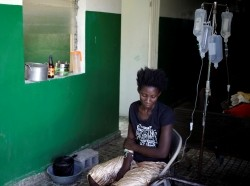 A woman receives treatment for cholera after Hurricane Matthew at a hospital in Les Anglais, Haiti, October 12, 2016
