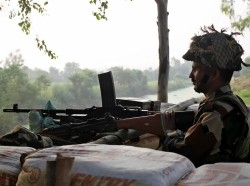 An Indian army soldier keeps guard from a bunker near the border with Pakistan in Abdullian, southwest of Jammu, September 30, 2016