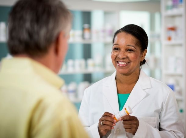 Pharmacist discussing a prescription with a patient