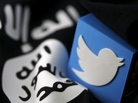 A 3D printed logo of Twitter and an Islamic State flag