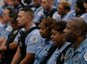 Chicago Police officers attend a news conference held by Superintendent Eddie Johnson announcing the department's plan to hire nearly 1,000 new police officers in Chicago, Illinois, September 21, 2016