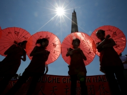 Young Chinese faithful shelter from the sun as Pope Francis leads the Angelus prayer in Saint Peter's Square at the Vatican, May 22, 2016