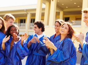 Group of high school students celebrating graduation, photo by Monkey Business Images/Fotolia