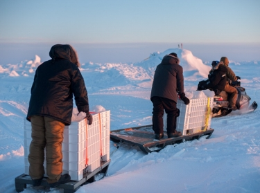 Sailors and civilians assigned to Arctic Submarine Lab haul ice to be used for potable water during an exercise, March 15, 2016