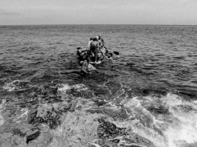 Would-be emigrants launch a makeshift boat into the Straits of Florida towards the U.S., on the last day of the 1994 Cuban Exodus in Havana, September 13, 1994