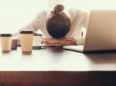 Tired businesswoman in the office