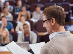 Professor and university students in a lecture hall