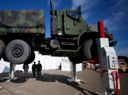 Soldiers look at a portable lifting system by Stertil-Koni at the Marine West Military Expo at Camp Pendleton, California, February 1, 2012