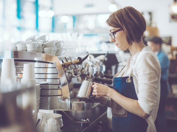 Young barista working in a cafe
