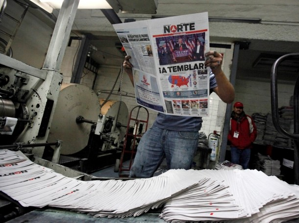 """A worker reads a freshly printed newspaper with the headline reading """"We will tremble"""" at a printer of the local daily Norte in Ciudad Juarez, Mexico, November 9, 2016."""