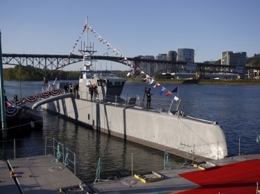 """The autonomous ship """"Sea Hunter"""" is shown docked in Portland, Oregon before its christening ceremony April 7, 2016"""
