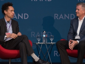 Journalist Malcolm Gladwell and Houston Astros' General Manager Jeff Luhnow at RAND's Politics Aside event in Santa Monica, November 12, 2016