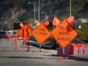 Flags and signs warn drivers about lane closures along Pacific Coast Highway near San Francisco, California